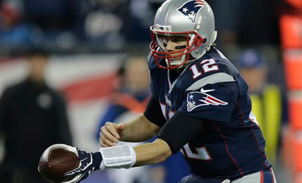In this Sunday, Jan. 18, 2015, photo New England Patriots quarterback Tom Brady hands the ball off during the first half of the NFL football AFC Championship game against the Indianapolis Colts in Foxborough, Mass. The NFL says its investigation...