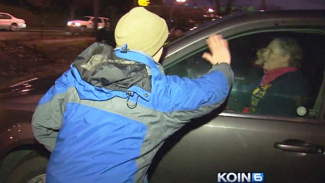 A counterprotester waves goodbye to a member of the Westboro Baptist Church after a failed anti-gay protest outside the Moda Center, Jan. 10, 2015 (KOIN 6 News)