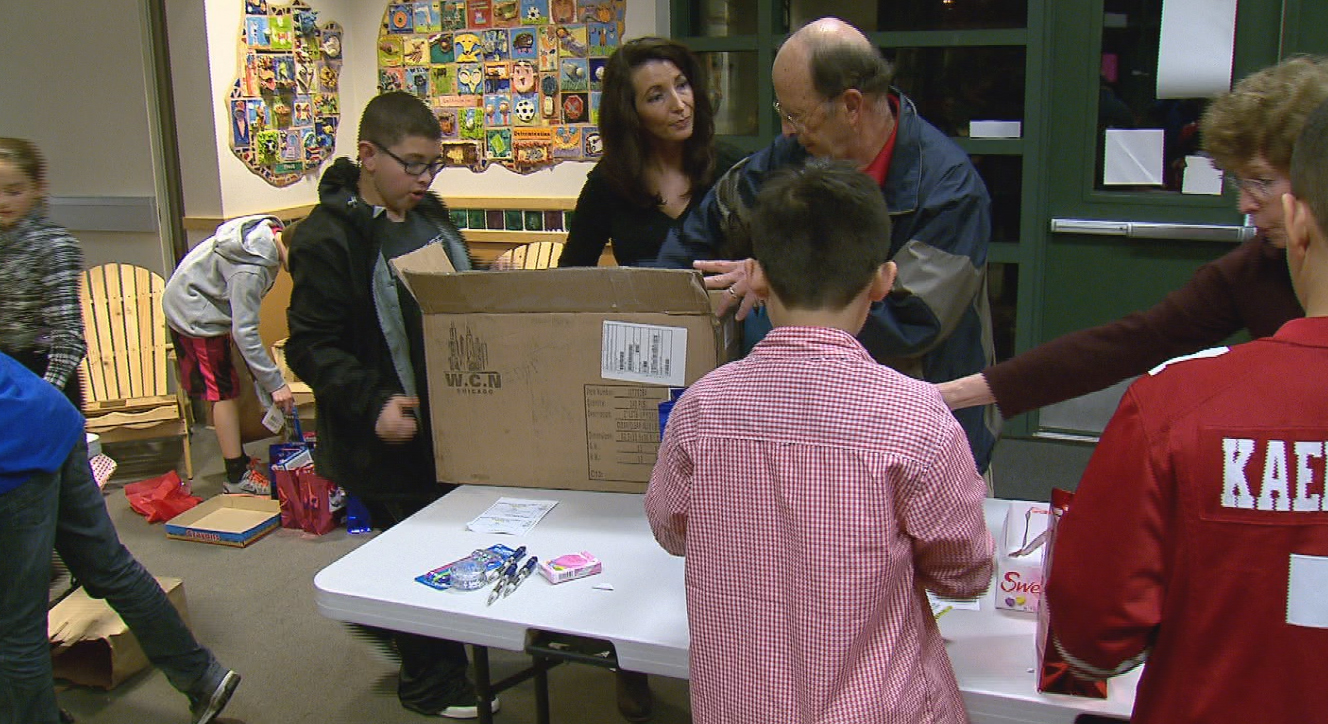 Students and family members packed Valentine's giftbags at Forest Park Elementary. February 12, 2015 (KOIN 6 News)