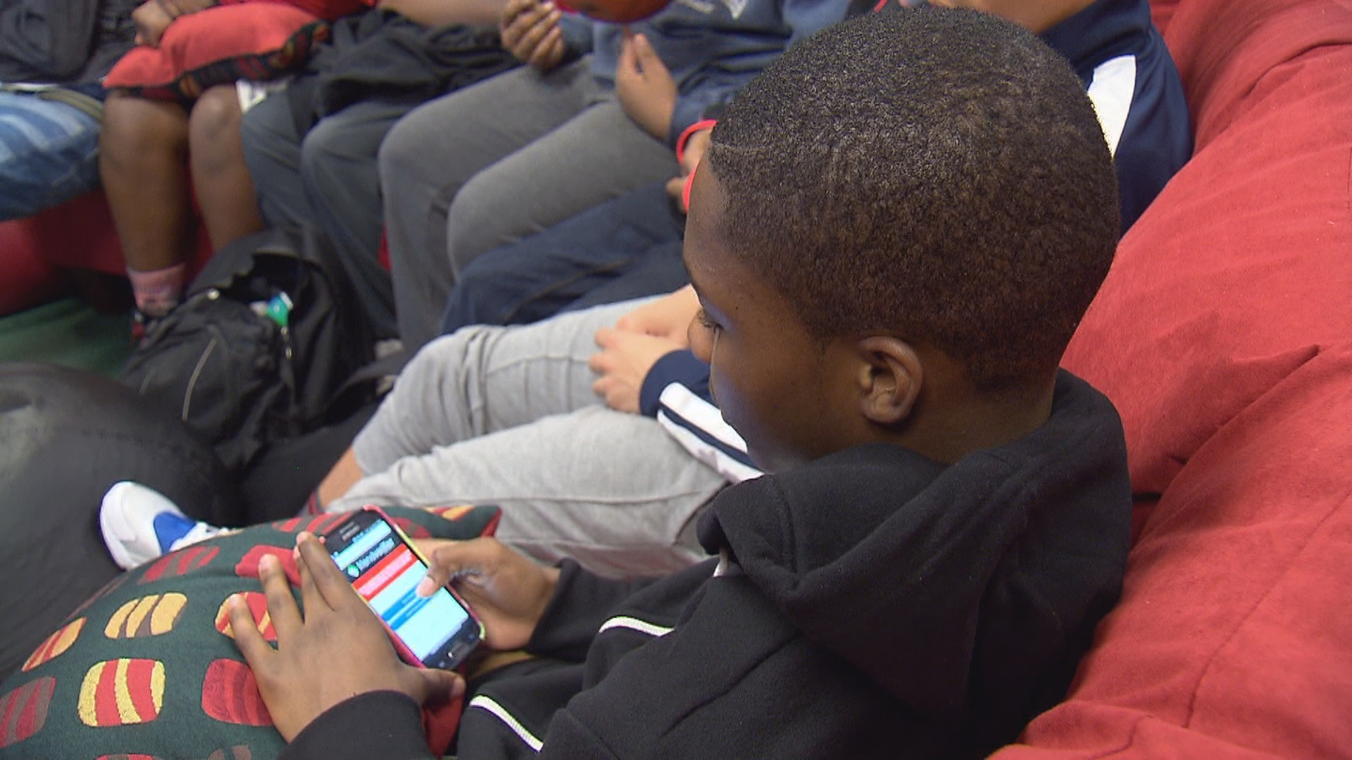 Teens test the app at Boys and Girls Club in Portland. (KOIN 6 News)
