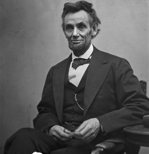 In this photo provided by the Library of Congress, President Abraham Lincoln, seated and holding his spectacles and a pencil on Feb. 5, 1865. (AP Photo/Library of Congress/Alexander Gardner)
