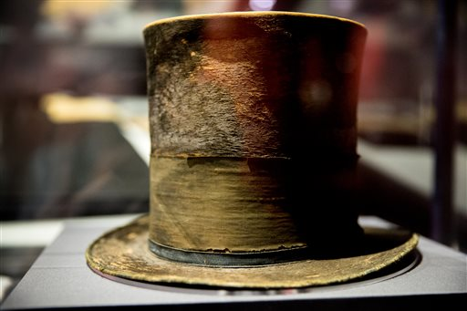 "In this March 17, 2015 file photo, President Abraham Lincoln's top hat from the night of his assassination is on display at a new exhibit entitled ""Silent Witnesses: Artifacts of the Lincoln Assassination"" at the Ford's Center for Education and..."