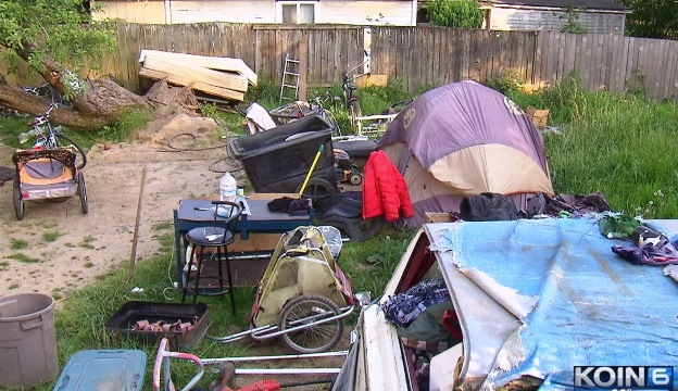 A baby was found alone in this tent in the backyard of a North Portland house. The mother, Taylor Kuhn, was arrested, May 8, 2015 (KOIN)