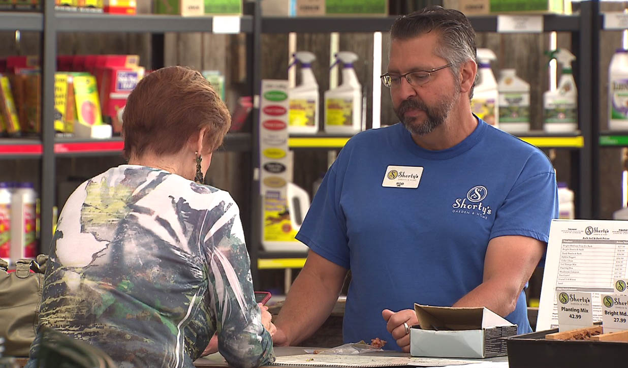 A customer checks out at  Shorty's Garden & Home in Vancouver, June 24, 2015. (KOIN)