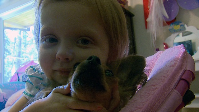 Lila  May Schow and her dog at their Hood River home, July 14, 2015 (KOIN)