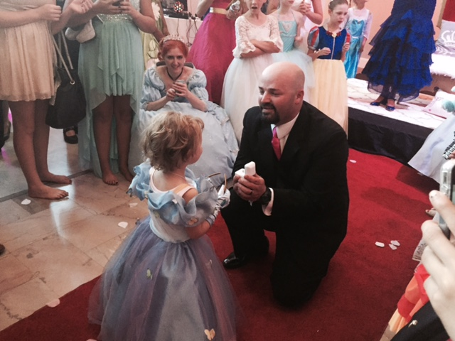 Lila May Schow  dances with stepdad, Blake Hall, at her Birthday Ball. The 5-year-old is battling neuroblastoma, July 31, 2015 (KOIN)