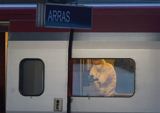 A police officer videos the crime scene inside a Thalys train at Arras train station, northern France, Friday, Aug. 21, 2015. A gunman opened fire with an automatic weapon on a high-speed train traveling from Amsterdam to Paris Friday, wounding...