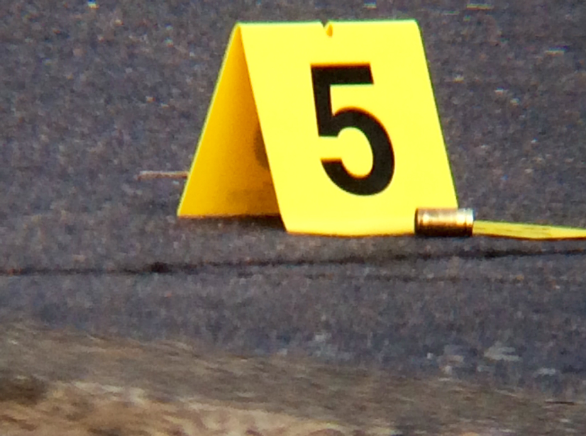 An evidence marker place next to a spent shell casing at an Aug. 2015 shooting (KOIN).