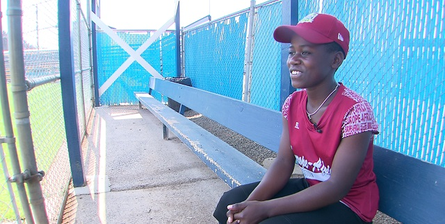 Ugandan team captain Gorret Komuhendo smiles prior to their game in the Little League Softball World Series in Portland, Aug. 18, 2015 (KOIN)