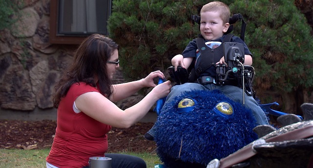 Bryce Weimer sits in his Halloween costume made by his dad, Ryan, who began a non-profit called Magic Wheelchair, Oct. 29, 2015 (KOIN)
