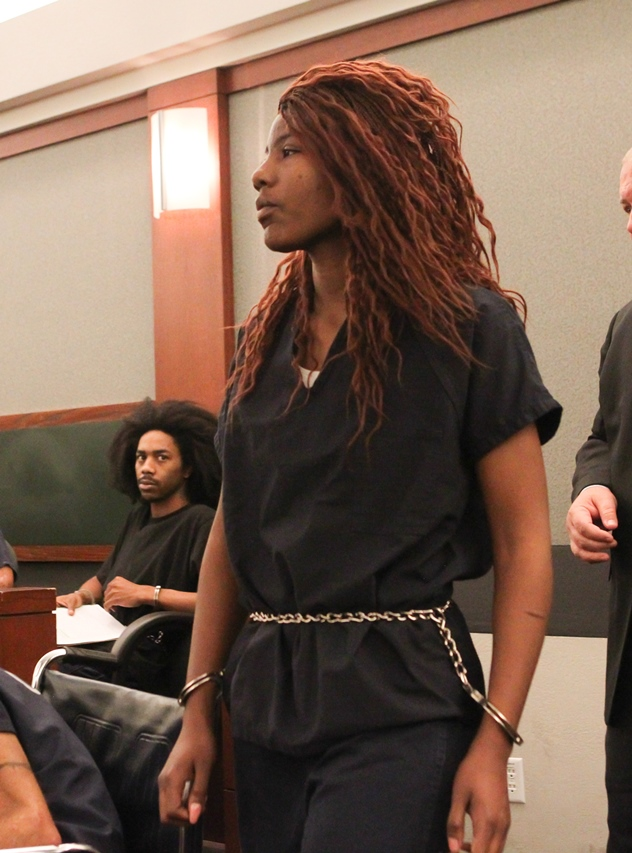 Lakeisha Nicole Holloway enters district court for her arraignment Wednesday, Dec. 23, 2015, in Las Vegas. Holloway, who crashed her car into pedestrians on the Las Vegas Strip on Sunday, Dec. 20, has been charged with murder, child abuse and...