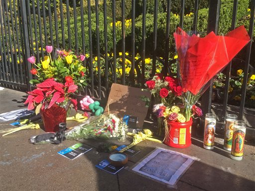 A makeshift memorial for crash victims appears on the strip in Las Vegas on Tuesday, Dec. 22, 2015. A woman accused of intentionally plowing a car carrying her young daughter through crowds of pedestrians on the Las Vegas Strip was charged Tuesday...
