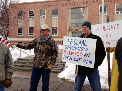 Protesters stand in front of the Harney County Courthouse in Burns, Ore., Friday, Jan. 29, 2016. Protesters were upset about the fatal police shooting of the spokesman for an armed group that has occupied a nearby wildlife refuge to protest land...