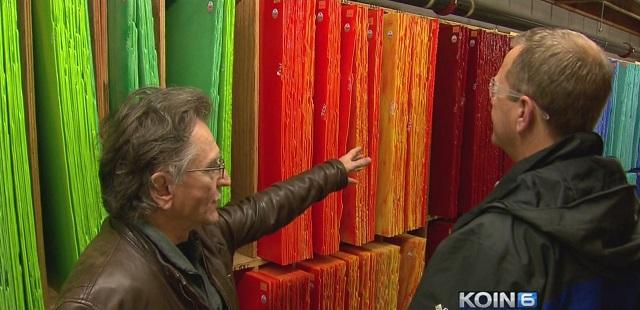 Bullseye Glass President Dan Schwoerer shows KOIN 6 News colorful glass made in his factory, Mar. 10, 2016 (KOIN)