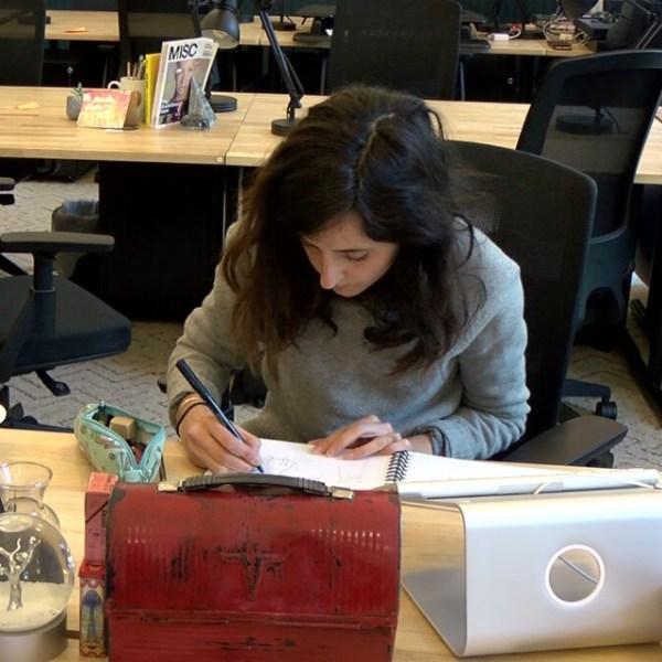 Brooke Barker works on her book at her WeWork desk. (KOIN)_306163