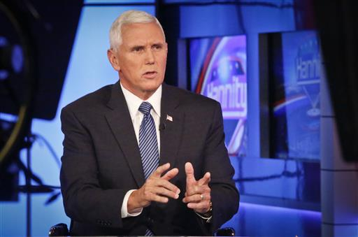 Indiana Gov. Mike Pence speaks during an interview with FOX News Channel's Sean Hannity after Donald Trump selected him for running mate on the Republican presidential ticket, Friday July 15, 2016, in New York. (AP Photo/Bebeto Matthews)