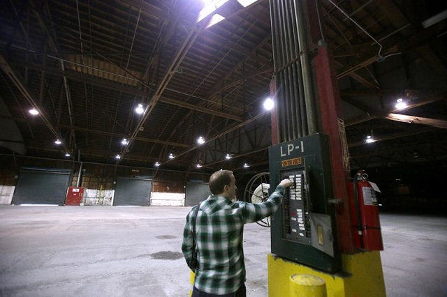 Bureau of Environmental Services property manager Eli Callison helps prepare the bureau-owned warehouse that sits at Terminal 1 for sale, July 2016 (Portland Tribune, Jonathan House)