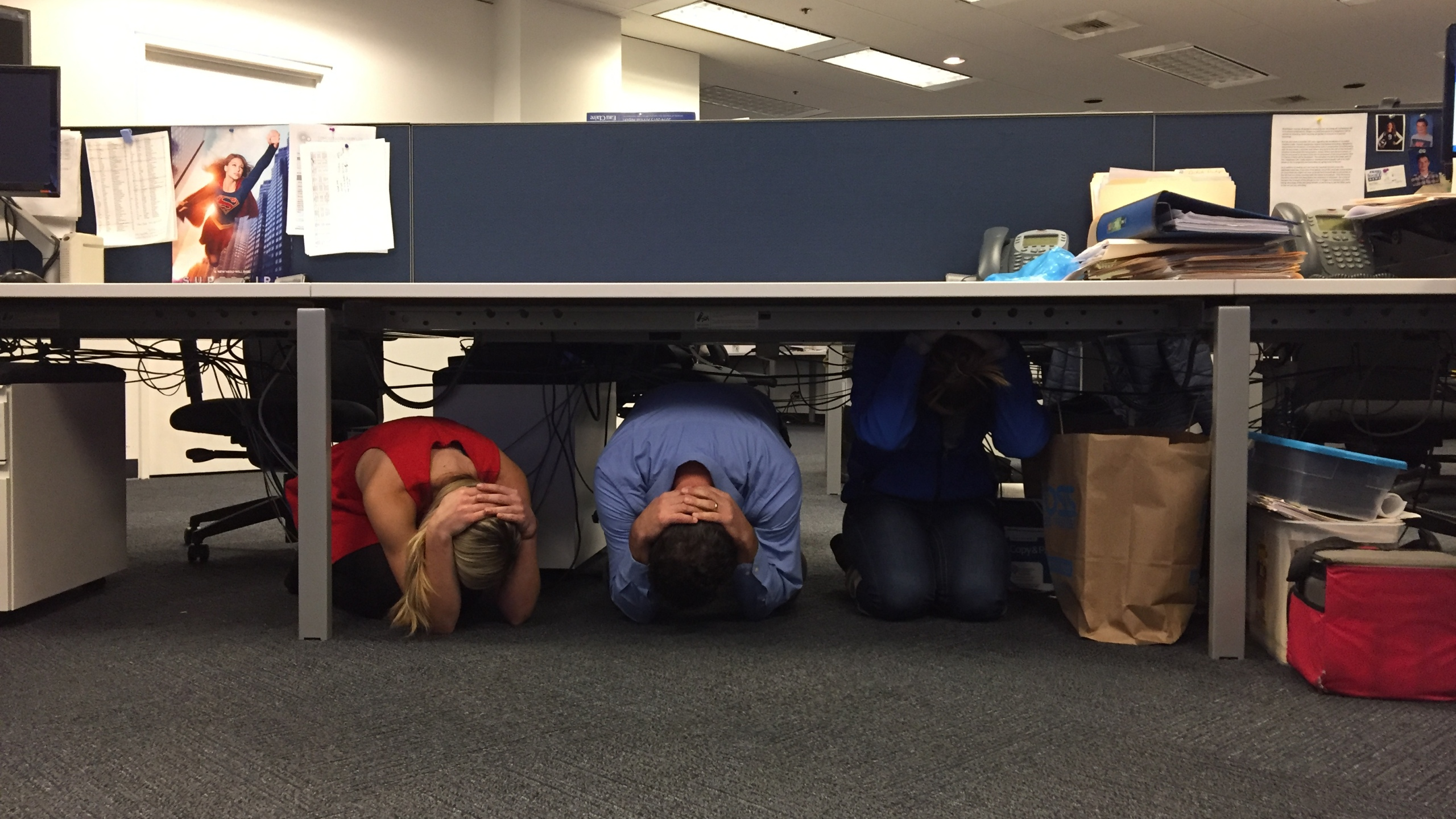 Participating in the GreatShakeOut drill in the KOIN 6 newsroom._360779
