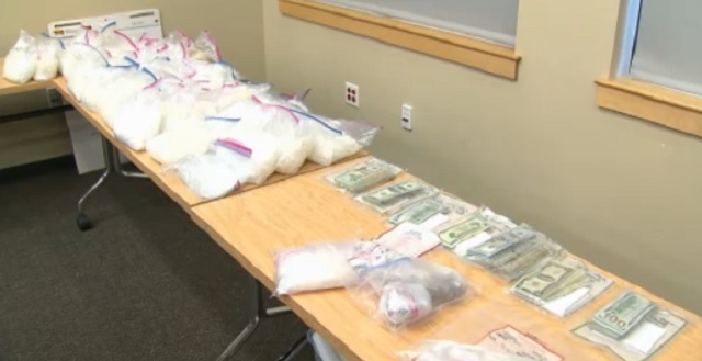 A drug bust in Troutdale seized 90-100 pounds of meth, 2 pounds of heroin, $30,000 in cash and firearms. Officials said the meth was worth $2 million and more than 50,000 doses were taken off the streets, February 23, 2017 (KOIN)