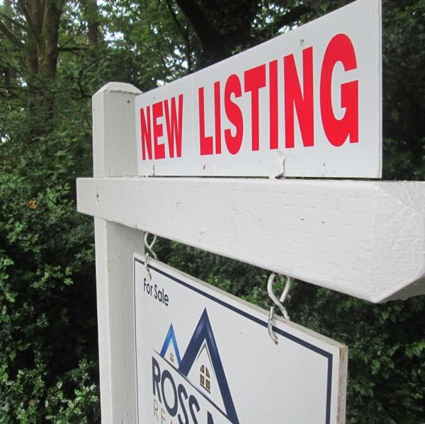 A for sale sign on a home. (Portland Tribune) generic new listing_414821