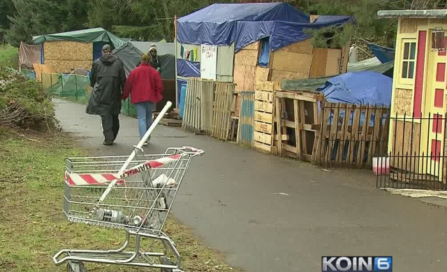 People walk down a path in a homeless camp in Portland, February 23, 2017 (KOIN)