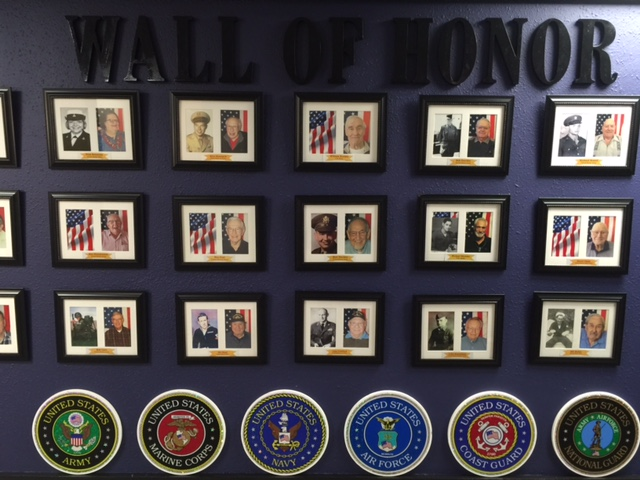 A Wall of Honor for the veterans at Holiday Retirement's Edgewood Downs in Beaverton, November 9, 2017 (KOIN)