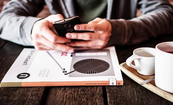generic man coffee smartphone 12292017_1514581356421.jpg.jpg