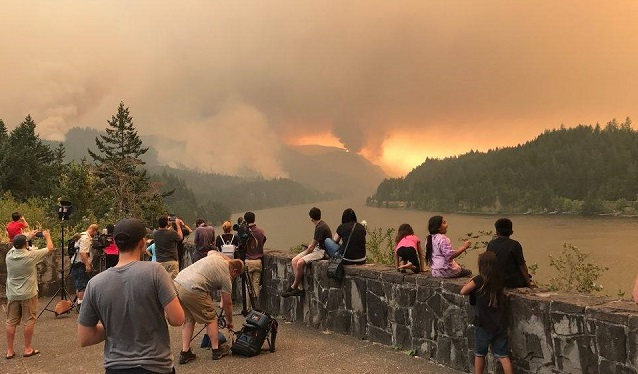 People watch the Eagle Creek Fire grow in the Columbia River Gorge, September 4, 2017 (Facebook: Eagle Creek Fire)