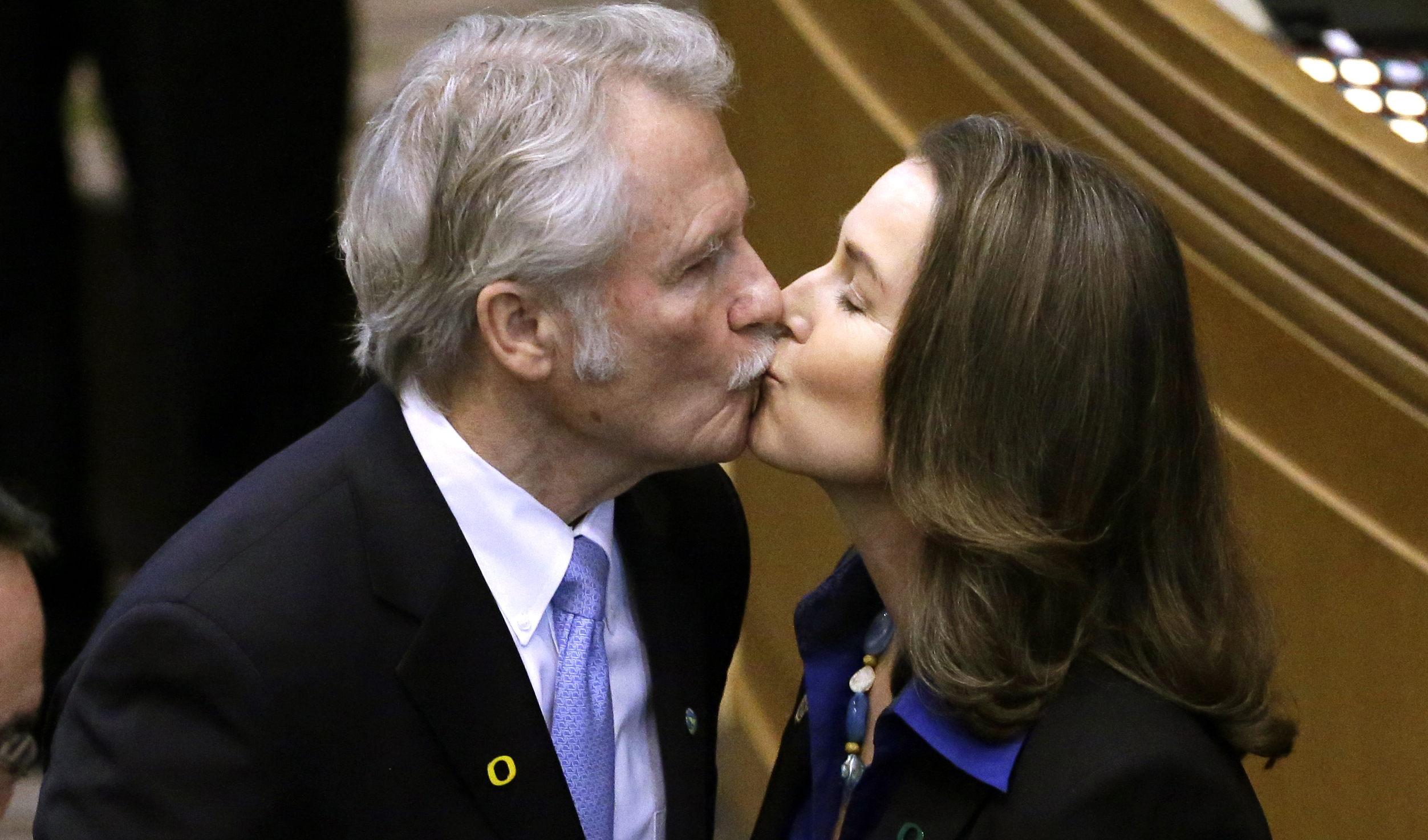 In this Jan. 12, 2015 file photo, Oregon Gov. John Kitzhaber kisses fiancee, Cylvia Hayes, after he is sworn in for an unprecedented fourth term as Governor in Salem, Ore.  (AP Photo/Don Ryan)
