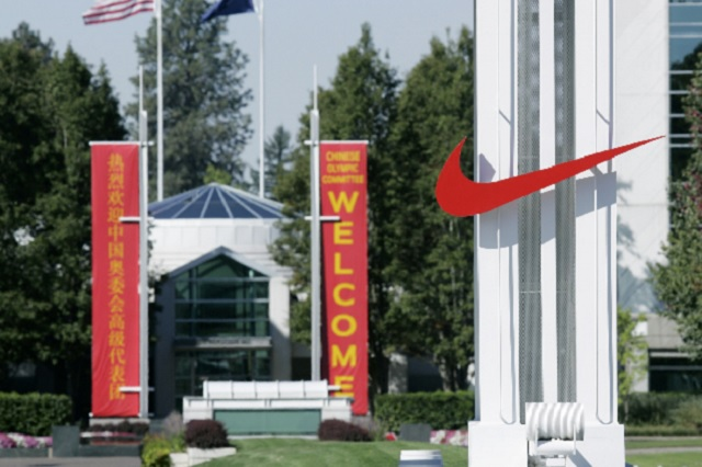 FILE - In this Sept. 29, 2006 file photo, the red Nike swoosh marks the entrance to the company's headquarters campus in Beaverton, Ore. (AP Ph_153744