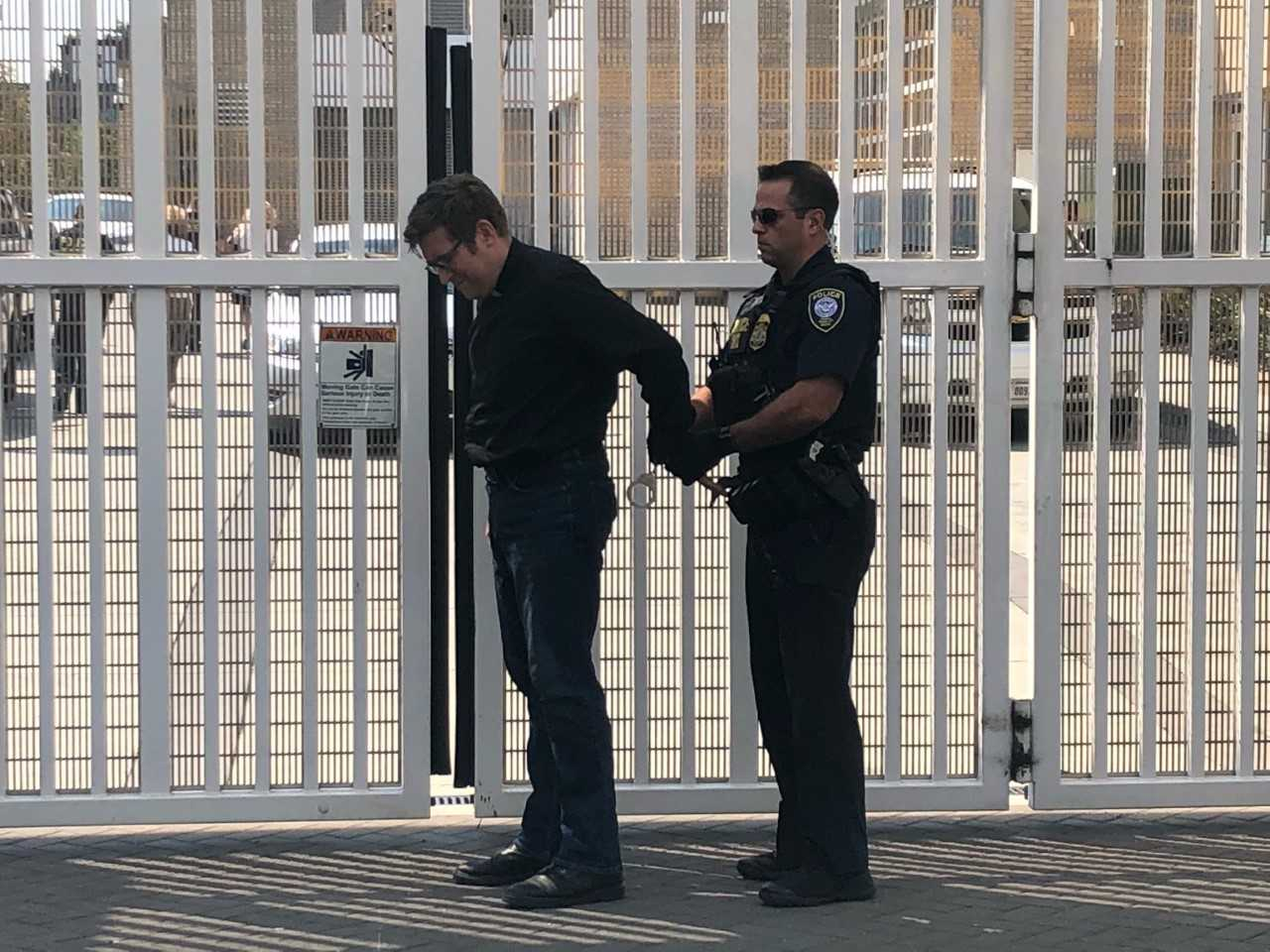 A clergyman was arrested at an ICE protest in SW Portland, August 7 2018. (ACLU)