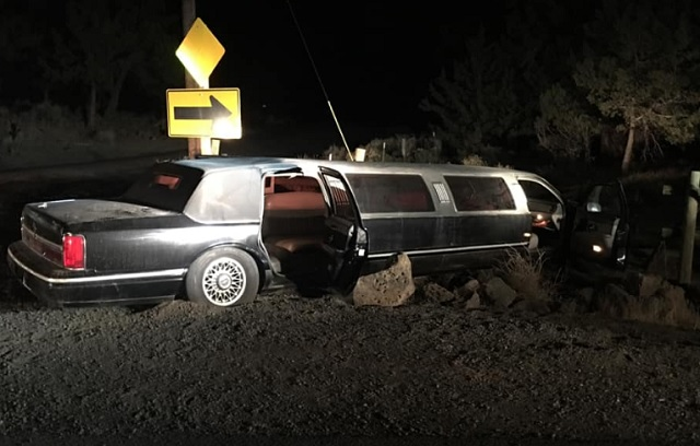 Limo crashes through fence in horse pasture