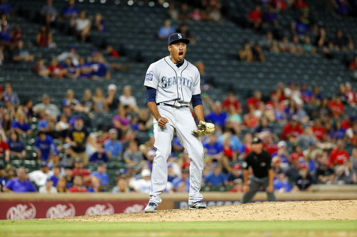 Seattle Mariners closer Edwin Diaz (39) celebrates getting the final out against the Texas Rangers in the ninth inning of a baseball game, Monday, July 31, 2017, in Arlington, Texas. The Mariners won 6-4. (AP Photo/Tony Gutierrez)