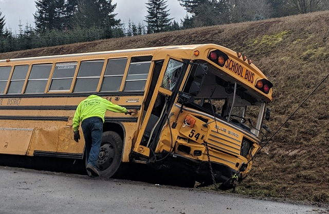 At least 10 injured after school bus, cars crash
