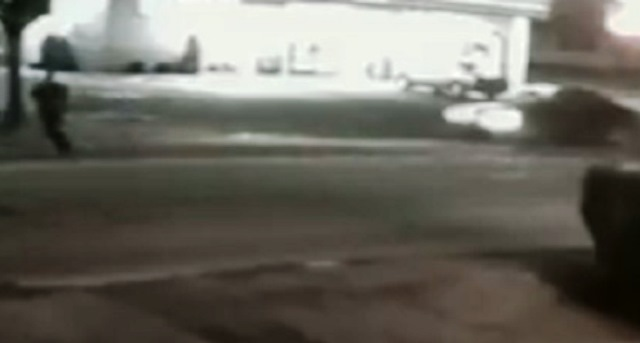 Ted Jones (left) hurries across SE 82nd a moment before being hit and killed by the car on the right, May 5, 2017 (Released by Crime Stoppers of Oregon, May 19, 2017)