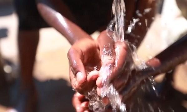 Malawi hands water charity water_1558592571290.jpg.jpg